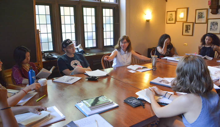 "Kathryn Slanski, senior lecturer in humanities and Near Eastern languages, leads a class of local high school students for ""Citizens, Thinkers, Writers,"" a summer program she helped found last year. Photo by Mike Marsland."