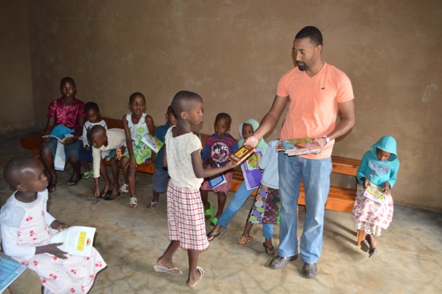 Gasana distributing books at the center during his last visit. (Photo courtesy of Parfait Gasana)