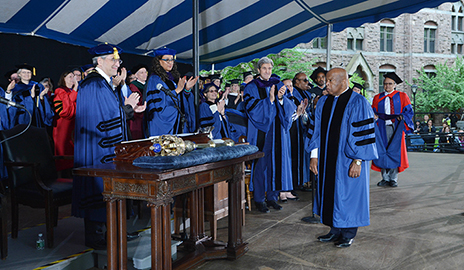 Civil rights activiist John R. Lewis received a standing ovation when he received his honorary degrees.