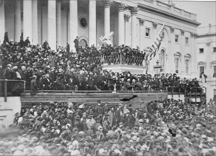 Alexander Gardner's photograph of Lincoln's second inauguration is the only known photograph of the event. Lincoln is standing at the center, papers in hand, delivering his address. (Beinecke Rare Book and Manuscript Library, Meserve-Kunhardt Collection)