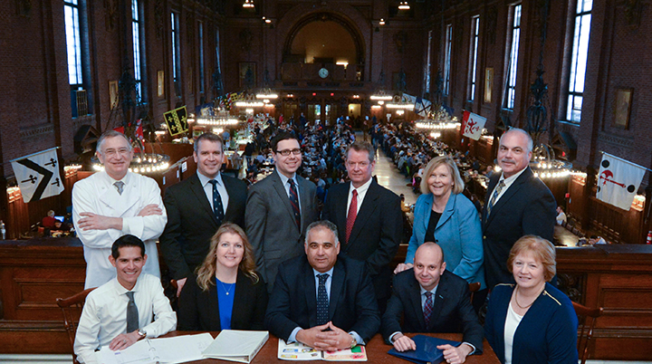 Pictured are some of the members of the Yale Hospitality team. Back row, from left — Ron DeSantis, Michael van Emmenes, James Filtz, Dan Flynn, Cathy Van Dyke, and Robert Sullivan. Front row, from left — Pedro Tello, Dana Courtney, Rafi Taherian, Adam Millman, and Gerry Remer. (Photo by Michael Marsland)