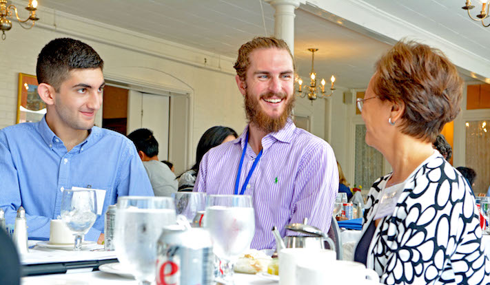 "Executive Director of the AYA Weili Cheng '77 (right) converses with two current students over lunch at ""Career Skills and Life Design."" Weili advocates for stronger connections between students and alumni through the AYA and ""Careers."" Photo by Karin Shedd."