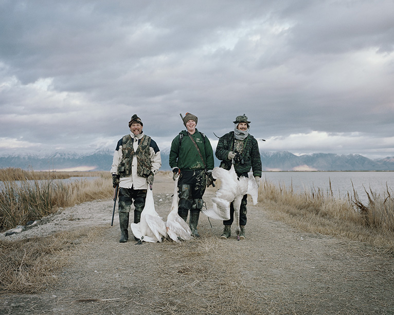 """""""Three Hunters with Swans,"""" taken by Marion Belanger in 2003 at the Bear River Migratory Bird Refuge in Utah."""