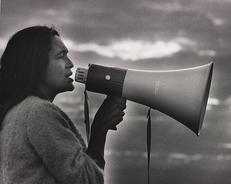 Labor leader Dolores Huerta speaks into a bullhorn in this 1965 photograph by Jon Lewis, who documented the rise of the farm worker's movement in California.