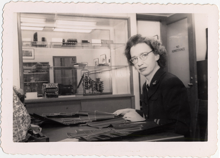 Grace Murray Hopper seated at her desk.
