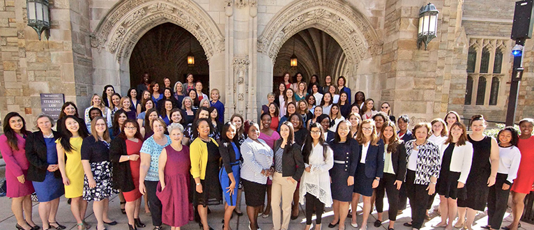 Women's Campaign School at Yale's Class of 2018 posing in front of the Yale Law School building.