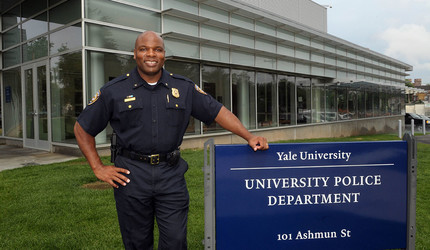 Yale Police Department Chief Ronnell Higgins posing in front of the university police department building.