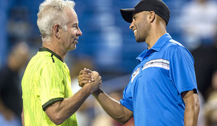 Tennis players John McEnroe and James Blake clasping hands.