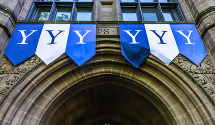 Yale banners over Phelps Gate.