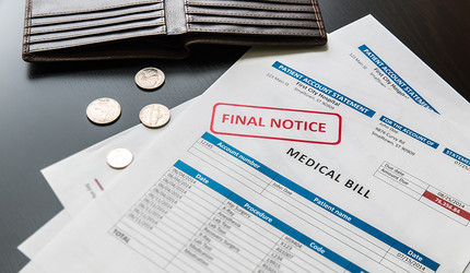 A final notice medical bill and an empty wallet.