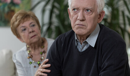 An married senior couple, with an angry-looking husband