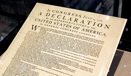 A photograph of the Declaration of Independence.