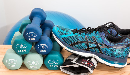 Dumbbells, an athletic shoe, and an exercise ball.