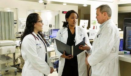 Dr. Christine Ngaruiya with colleagues on the hospital floor.