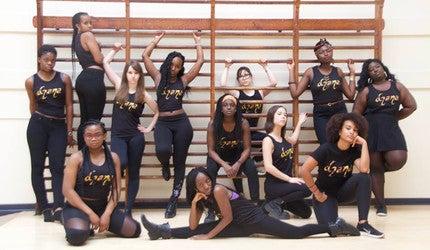A troupe of dancers in black leotards