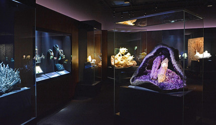 Brightly lit exhibits of gems and minerals at the Peabody