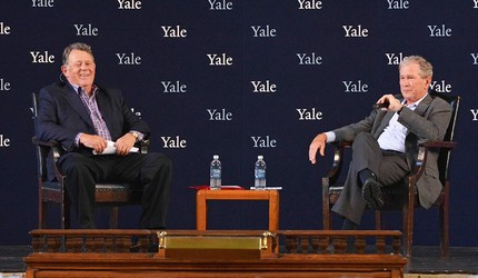 Roland Betts and former president George W. Bush on stage at Woolsey Hall for a discussion during their 50th Yale reunion.