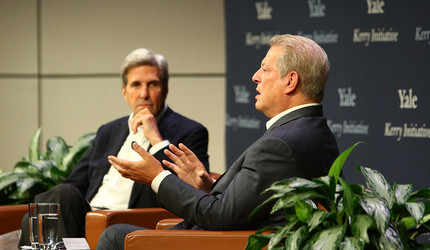 Photo showing John Kerry in the background and Al Gore in the foreground, talking.
