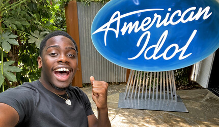 Xavier Washington with an American Idol sign behind him.