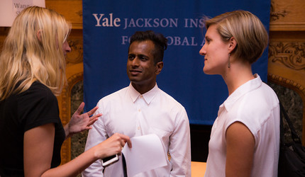 Joshin Raghubar with two women at a Yale event.