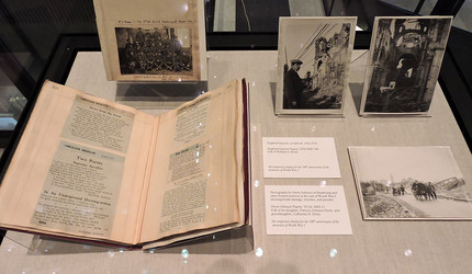 Poems by Siegfried Sassoon and Owen Johnson in a display case.