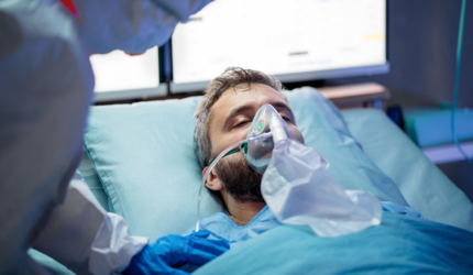 A man breathing with a ventilator