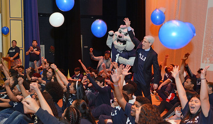 Peter Salovey, Boola, and New Haven students celebrate at the Snowball event on Feb. 1.