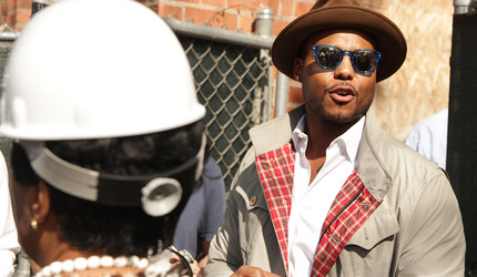 Titus Kaphar '06 M.F.A. leads a press tour of the NXTHVN complex for local media and city officials.