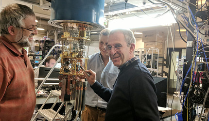Photo of Luigi Frunzio, Robert Schoelkopf, and Michel Devoret working in a Yale laboratory.