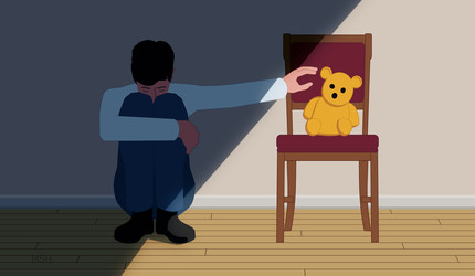 A frightened child reaching for a teddy bear