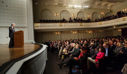 Photo of Peter Salovey onstage talking to an audience of alumni