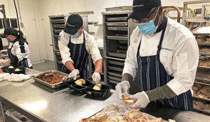 Yale Hospitality workers assemble Thanksgiving meals for students on campus and members of the New Haven community.