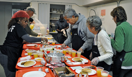 Volunteers serve food at a New Haven breakfast program for the homeless.