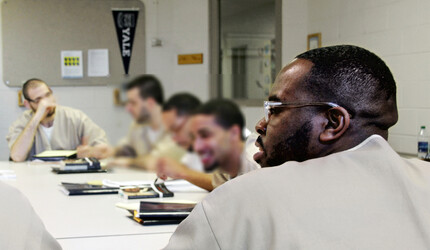 Inmates in a classroom.
