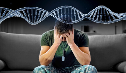 Man with head in his hands with image of DNA helix above him.