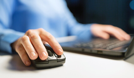 Man using a computer mouse.