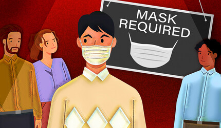 Masked person surrounded by unmasked people.