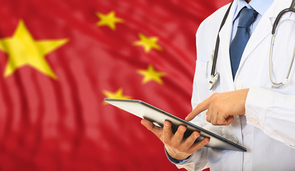 A composite image of a doctor and the Chinese flag