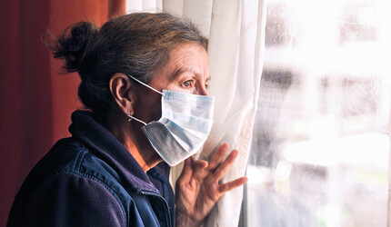 Elderly woman in a nursing home with a face mask on