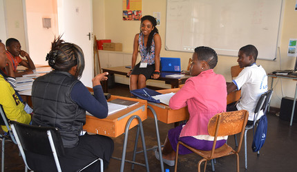 Yaa Oparebea Ampofo '16, Mentorship Coordinator for the Yale Young African Scholars program, with a group of students.