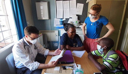 Dr. J. Zachary Porterfield, research assistant Pume Mhlongo, and Dr. Julia Toman