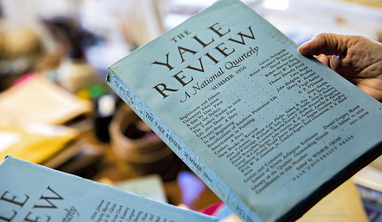 A person holding an old copy of the Yale Review
