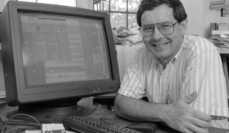 Ronald Coifman posing with a computer.