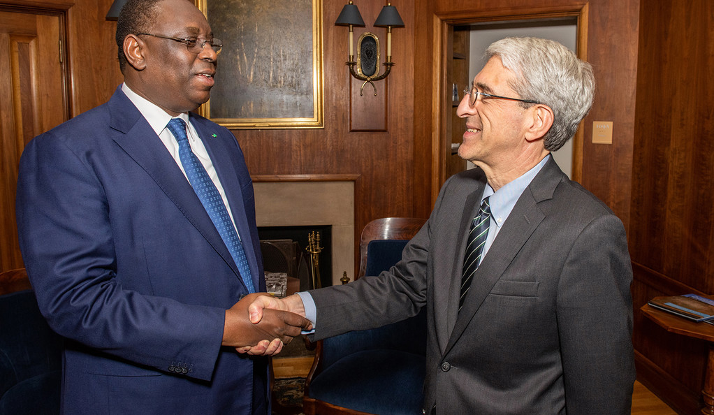 His Excellency Macky Sall, president of the Republic of Senegal, greets President Peter Salovey in his office.
