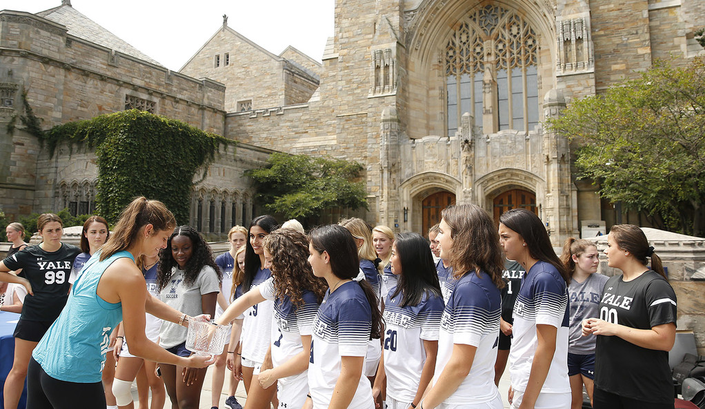 Julia Goerges conduct the tournament draw ceremony with help from members of the Yale women's soccer team.
