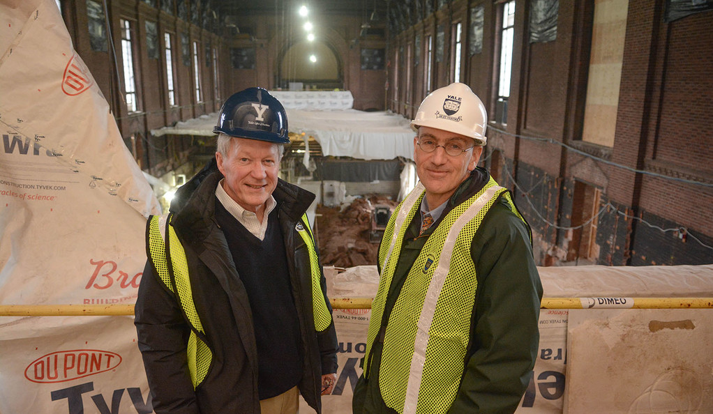 Deputy Provost Lloyd Suttle and Provost Ben Polak survey the construction inside Commons at the Stephen A. Schwarzman Center.