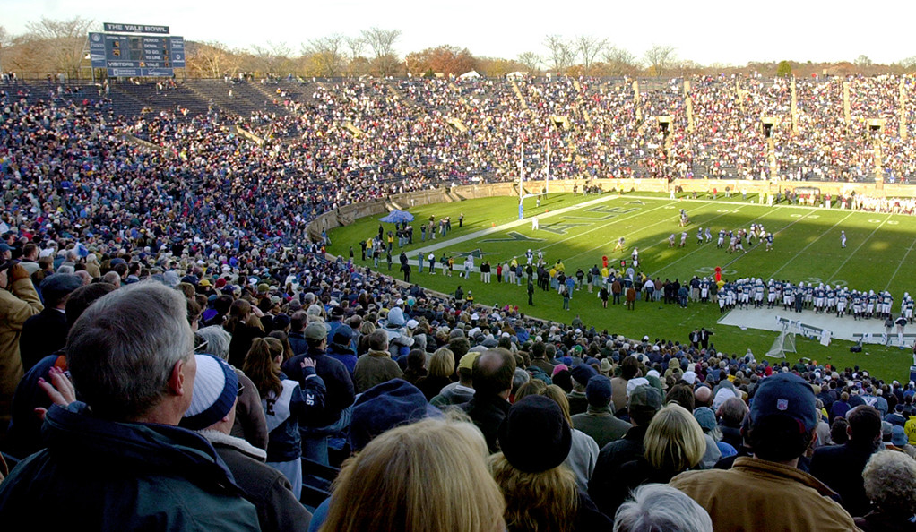 A packed crowd watches a game at the Yale Bowl