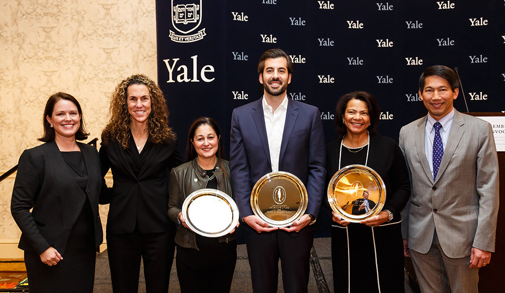 2018 Yale Alumni Fund Chairman's Award winners posing with their trophies and YAF leadership.