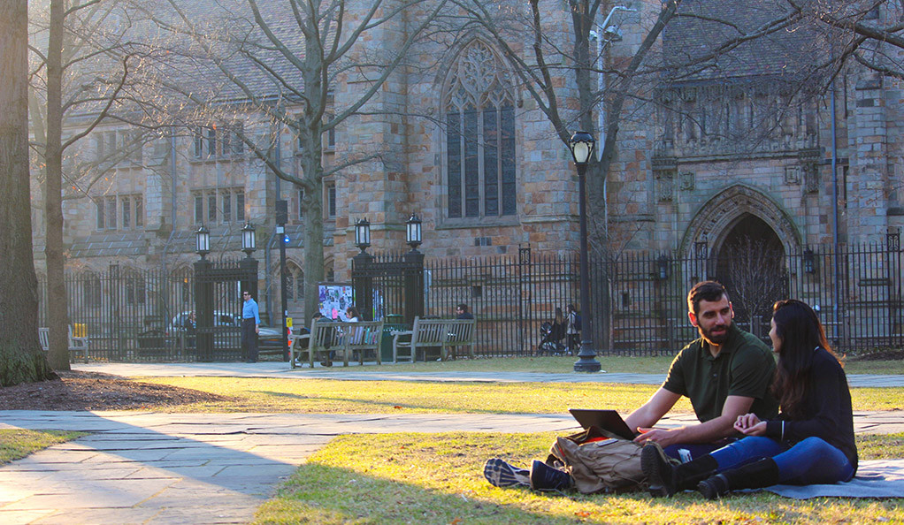 Students sitting on Old Campus at Yale.