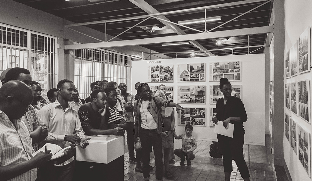 Doreen Adengo leads a guided tour of the Kampala exhibition.